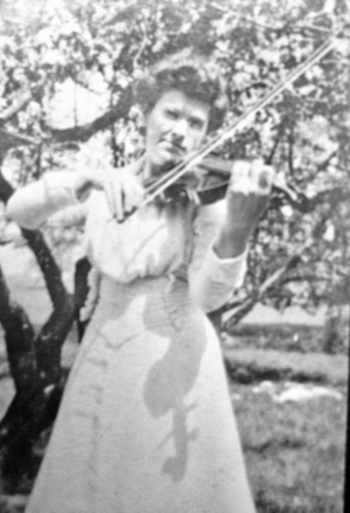 Carrie Grover playing her fiddle.